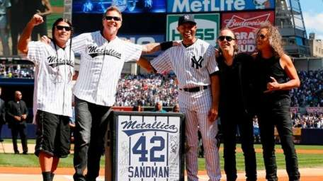 Rivera is presented with a gift from Metallica