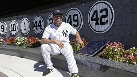 Yankees closer Mariano Rivera poses with a plaque
