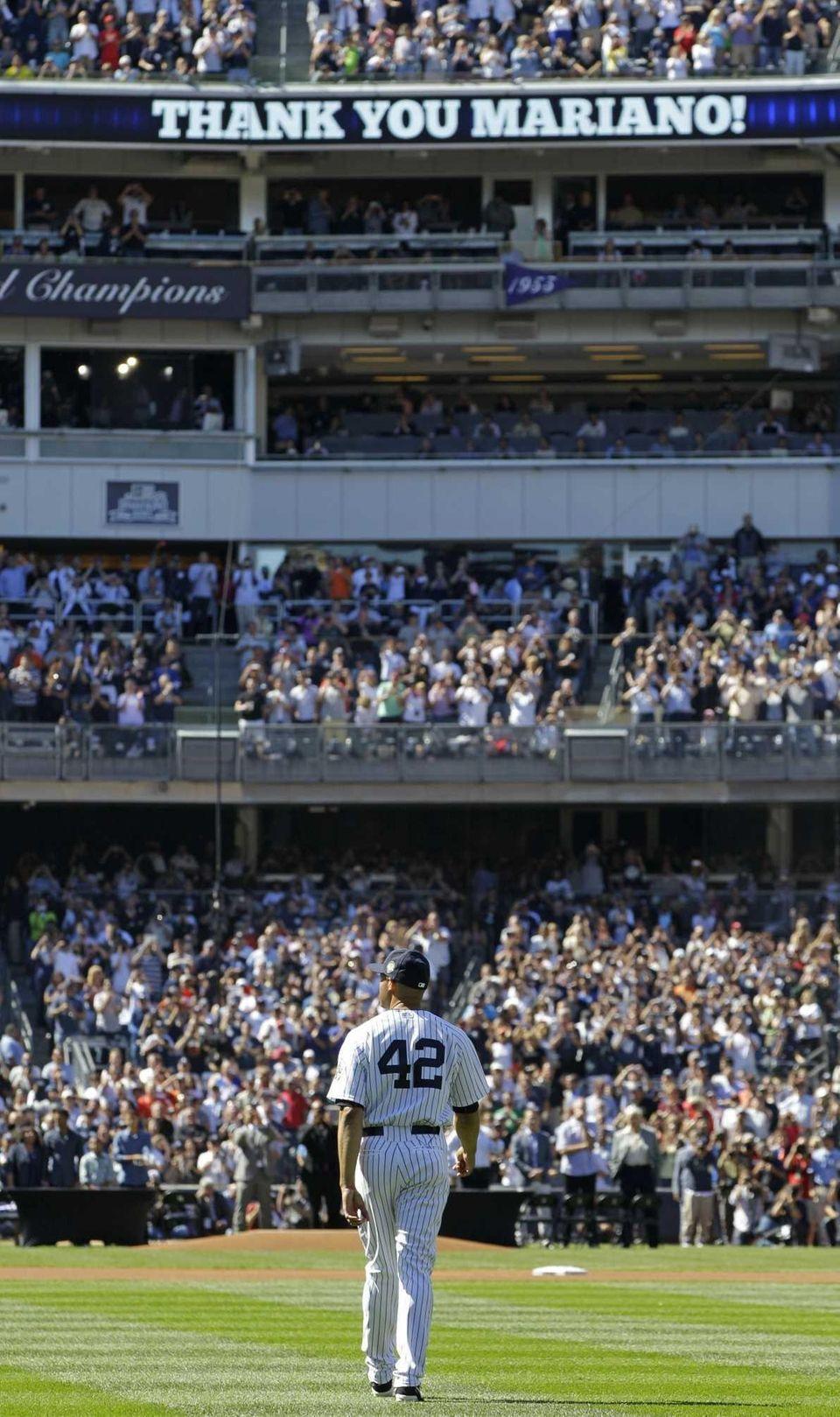 New York Yankees relief pitcher Mariano Rivera walks