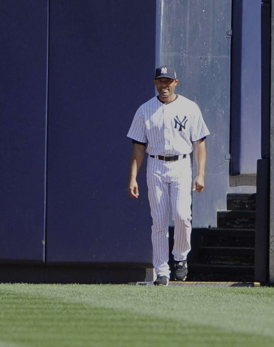 New York Yankees pitcher Mariano Rivera walks onto