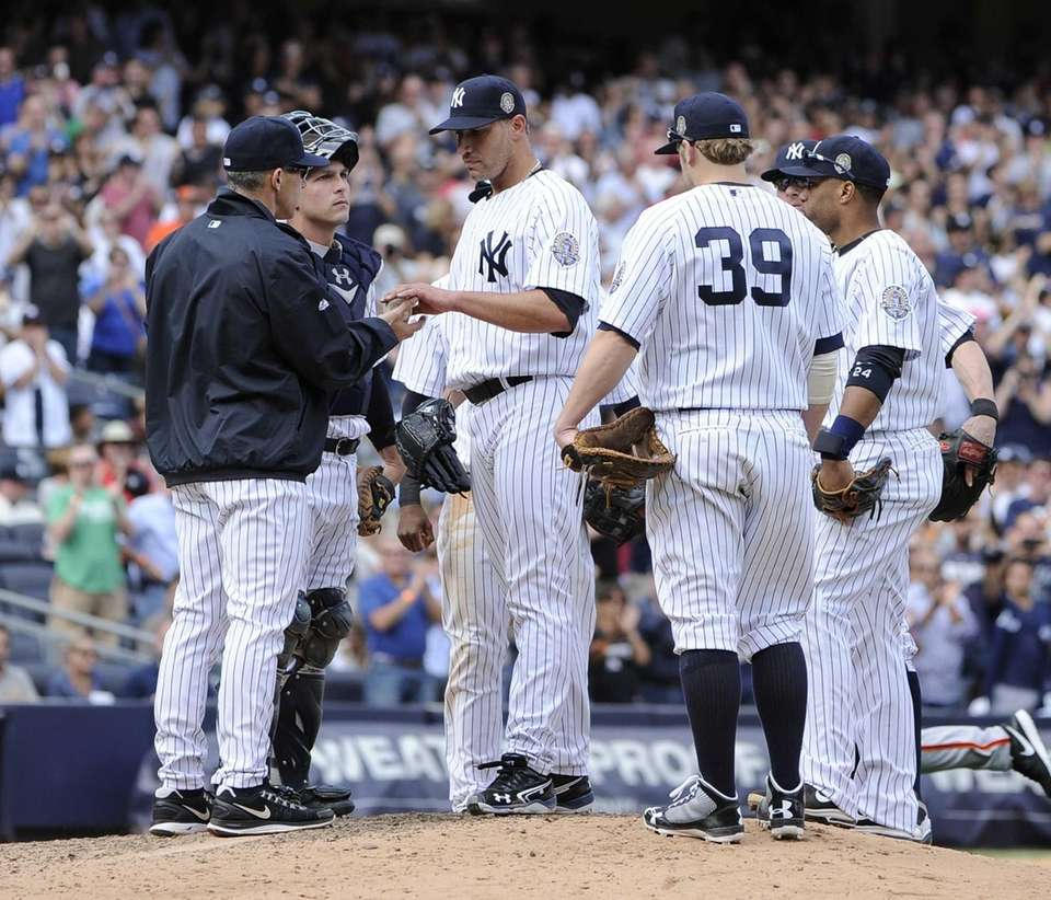 Yankees starting pitcher Andy Pettitte hands the ball