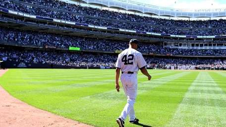 Yankees pitcher Mariano Rivera walks out of the