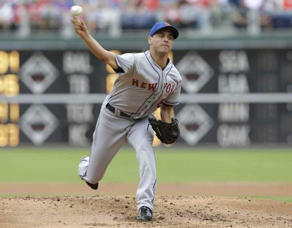 Carlos Torres of the Mets pitches against the