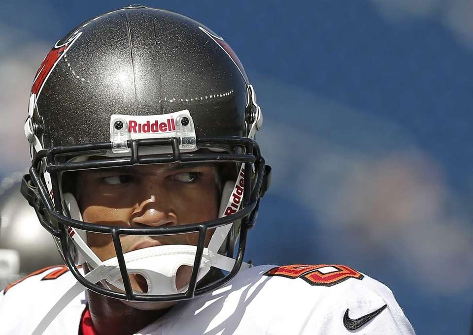 Tampa Bay Buccaneers quarterback Josh Freeman looks on