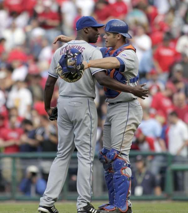 Mets pitcher LaTroy Hawkins, left and Anthony Recker