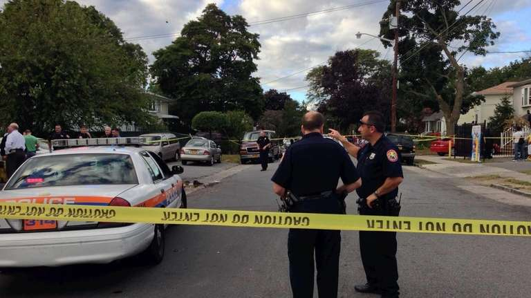 Police investigate a shooting in New Cassel. (Sept.