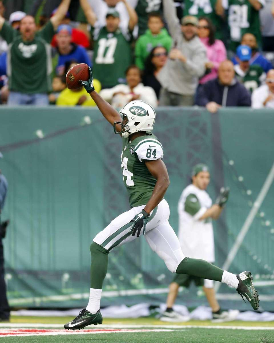 Jets receiver Stephen Hill celebrates as he runs