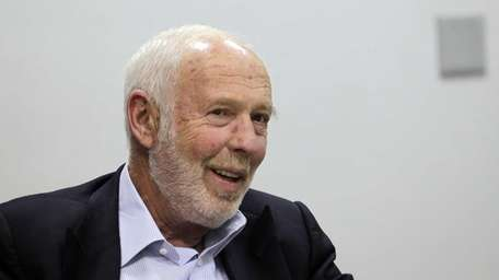 Hedge fund billionaire James Simons and his wife,
