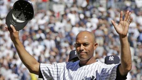 Yankees relief pitcher Mariano Rivera acknowledges the crowd