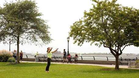 Kathy Tin of Brooklyn plays Frisbee in the