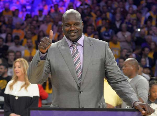 Former Los Angeles Lakers center Shaquille O'Neal gestures