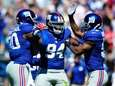 Jason Pierre-Paul #90 and Spencer Paysinger #51 congratulate