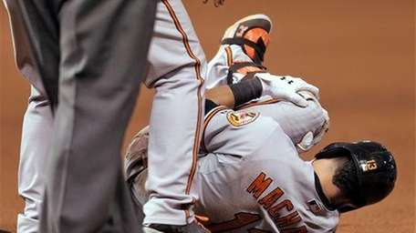 Baltimore Orioles third baseman Manny Machado grabs his