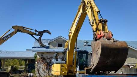 Construction crews begin demolition of the Bavarian Inn,