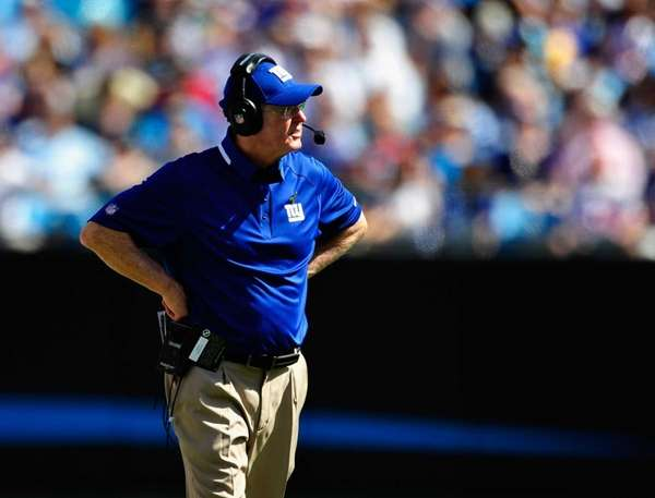 Tom Coughlin watches his team during a loss