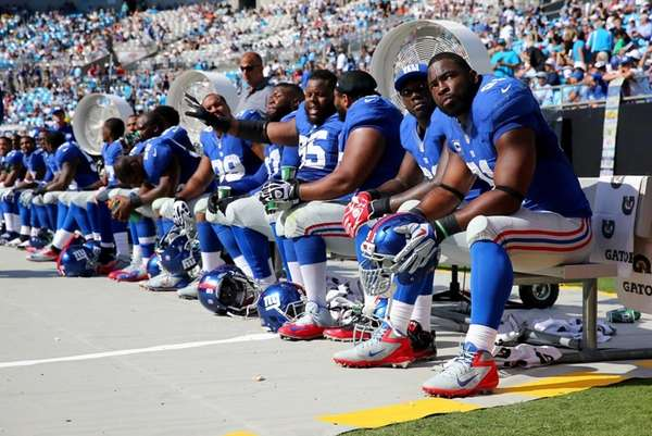 Justin Tuck sits on the bench during a