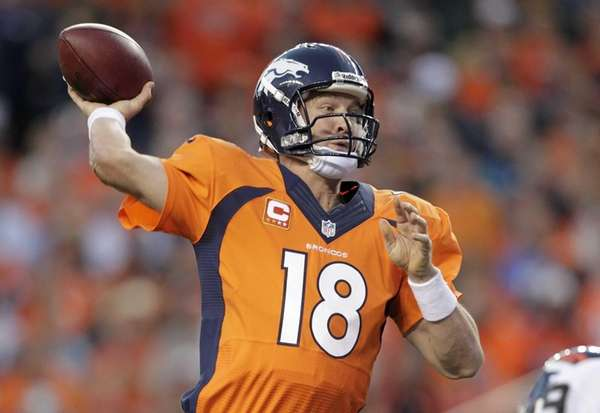 Denver Broncos quarterback Peyton Manning throws a pass