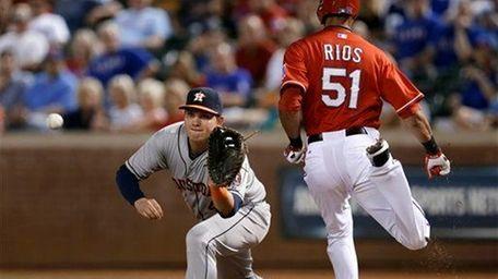 Houston Astros first baseman Chris Carter reaches out