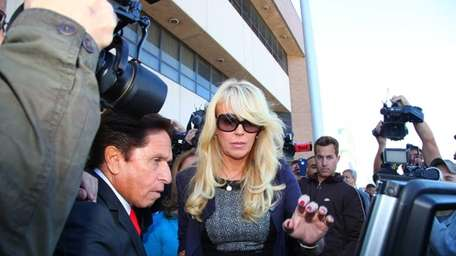 Dina Lohan leaves the Nassau County District Court