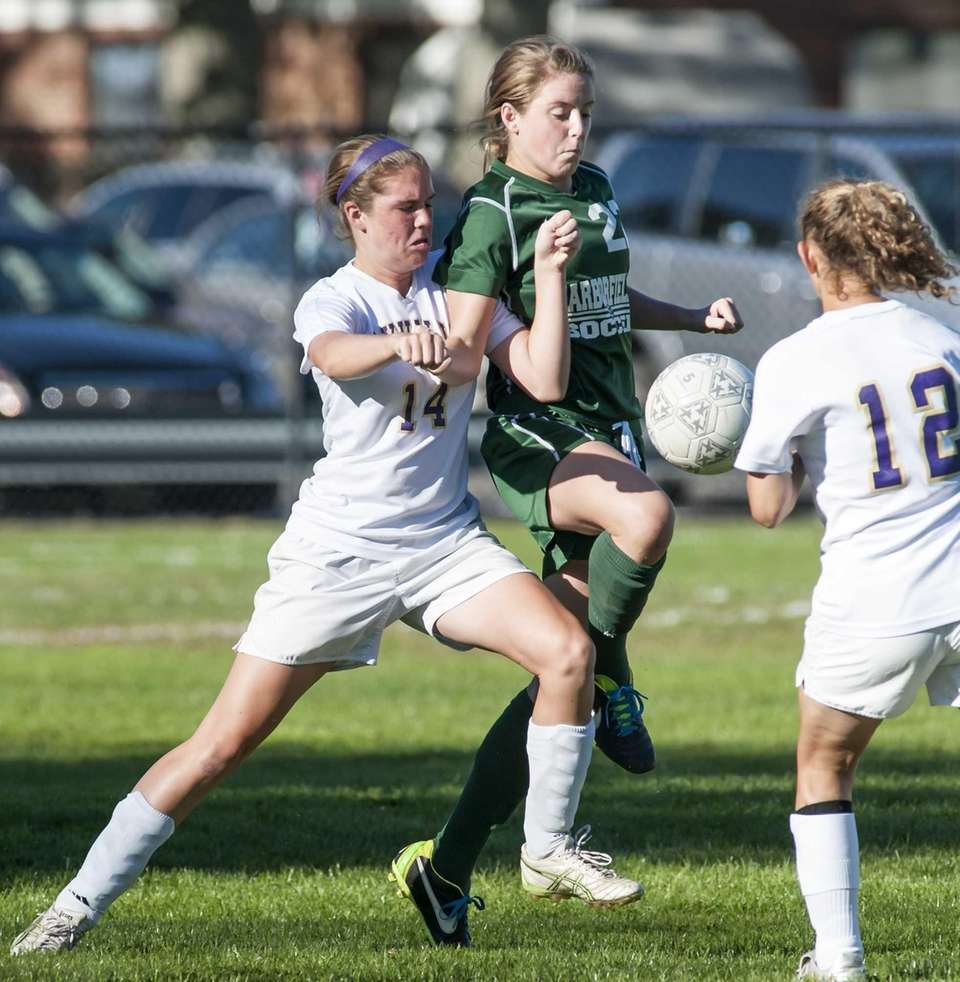 Harborfields' Caroline Wallace, center, goes after the ball
