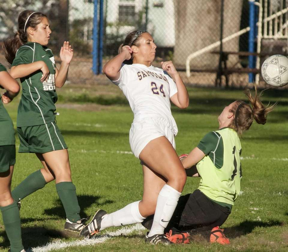 Harborfields goalie Gabbi Espinoza, right, deflects the shot
