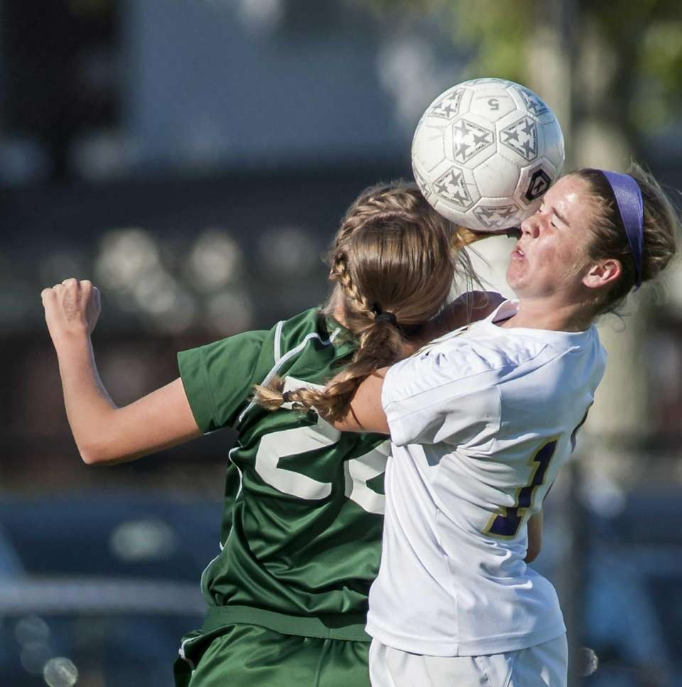Harborfields' Caroline Wallace, left, goes up for a