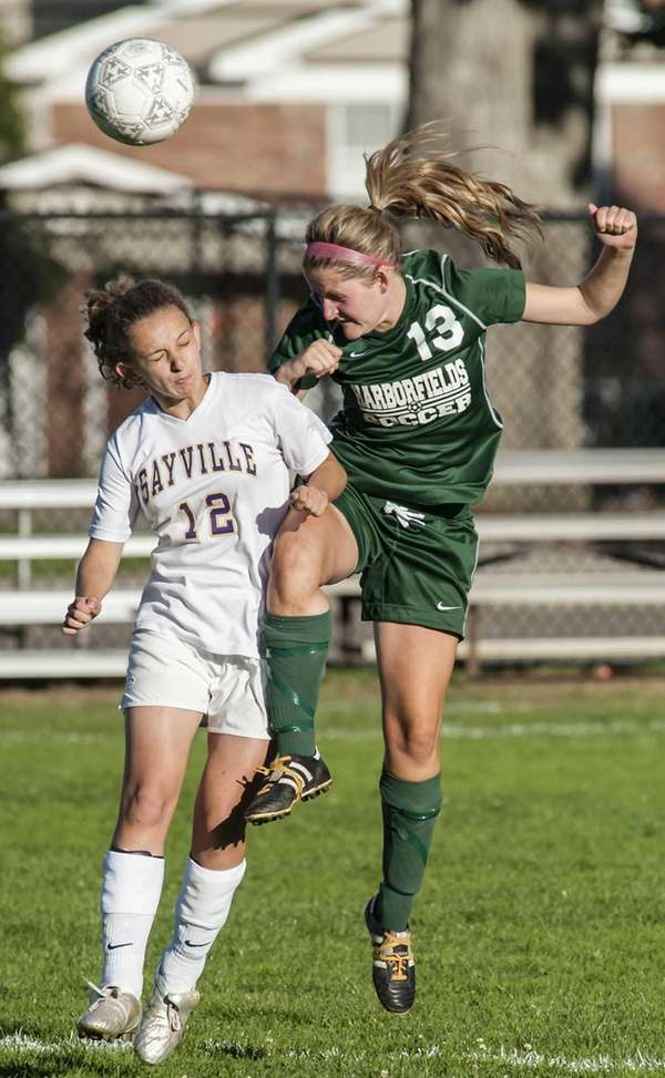 Sayville's Victoria Ross, left, goes up for a