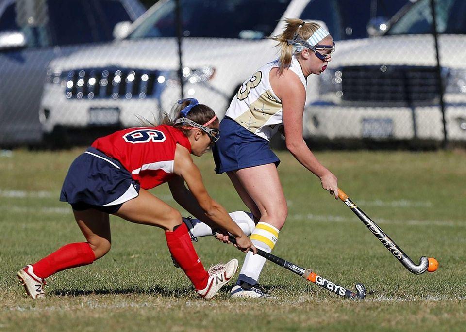 Bayport's Cassie Stucklen (13) controls the ball ahead