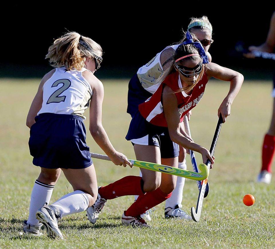 Miller Place's Kristin Roberto (16) advances the ball