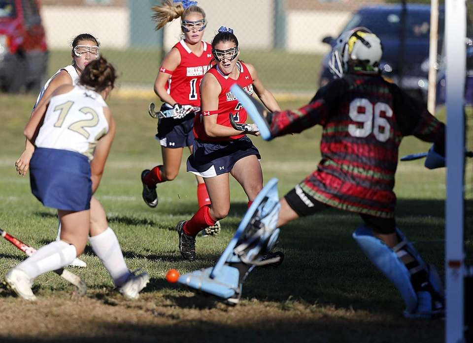 Miller Place's Ally Hutzler (7) shoots and scores