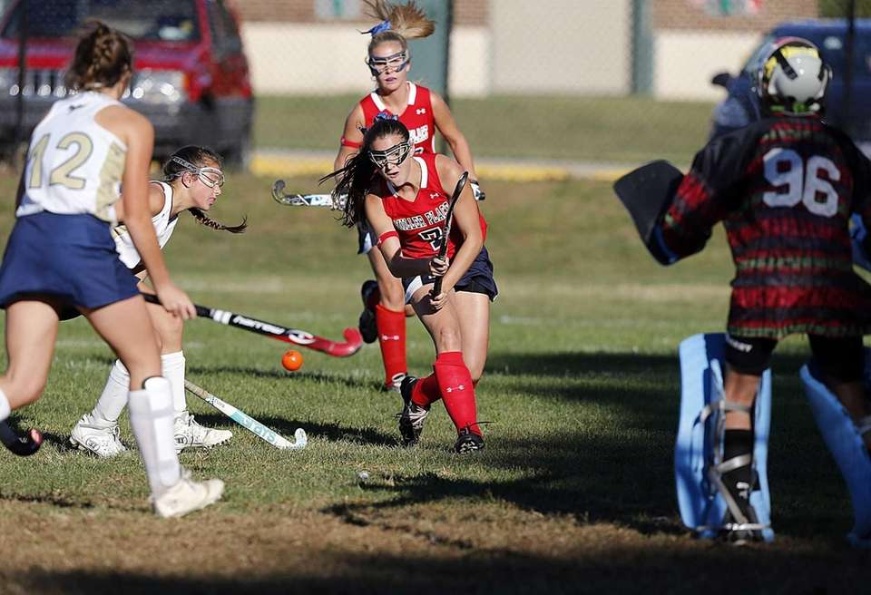 Miller Place's Ally Hutzler (7) shoots and score