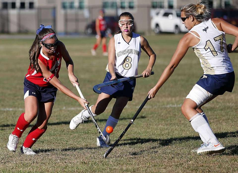 A Miller Place player battles for possession against