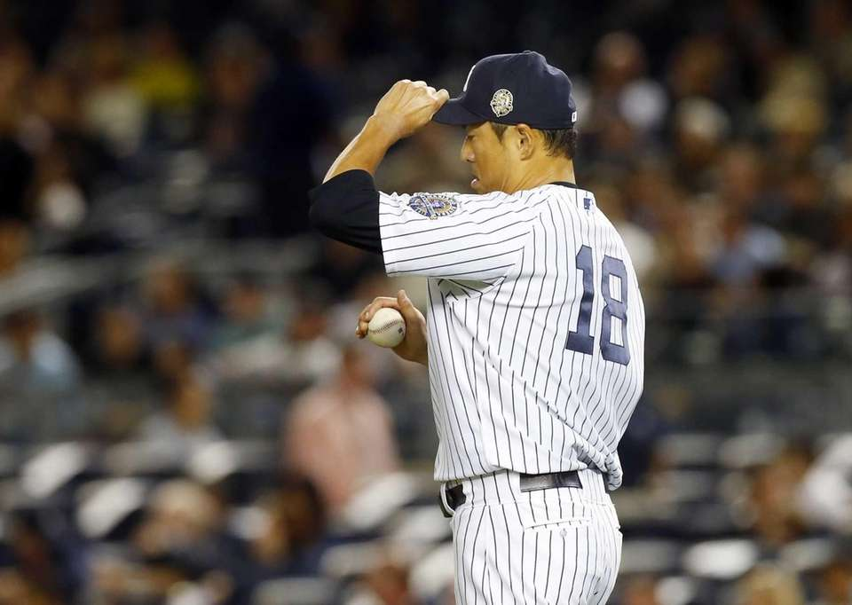 Hiroki Kuroda stands on the mound in the