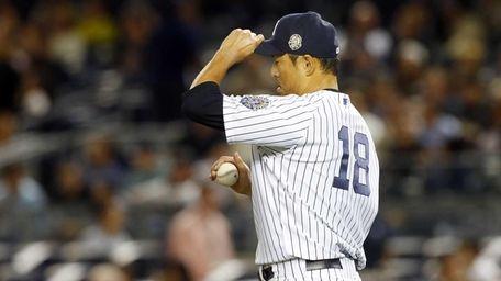 Hiroki Kuroda stands on the mound in the