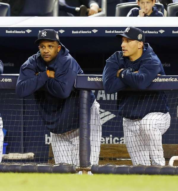 CC Sabathia #52 (L) and Andy Pettitte #46