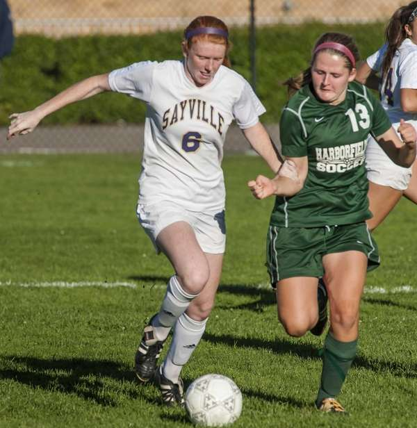 Sayville's Julianne Johnston, left, goes after the ball