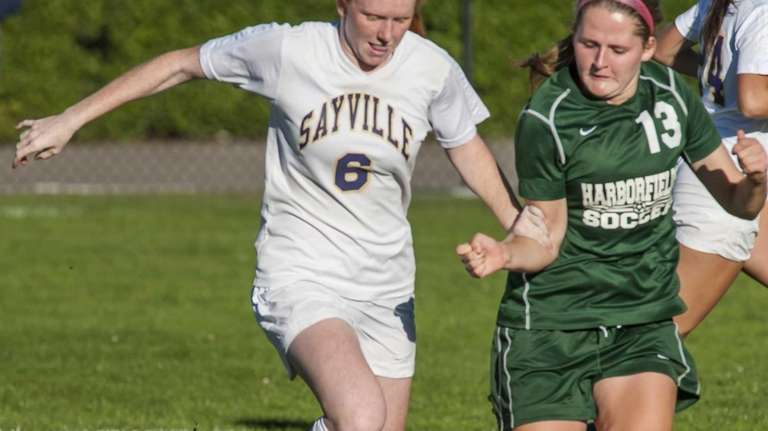Sayville's Julianne Johnston, left, goes after the ball