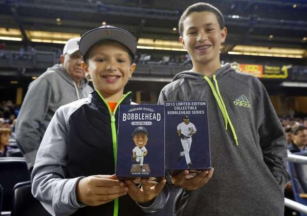 Jessie and Jonah Bernstein display their Mariano Rivera