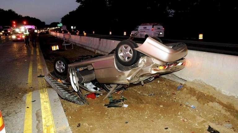 An overturned vehicle closed the left lanes of
