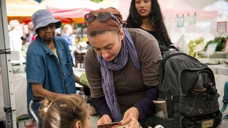 A woman and her daughter counts out Electronic