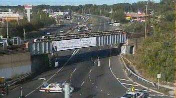 A traffic camera image shows police at the