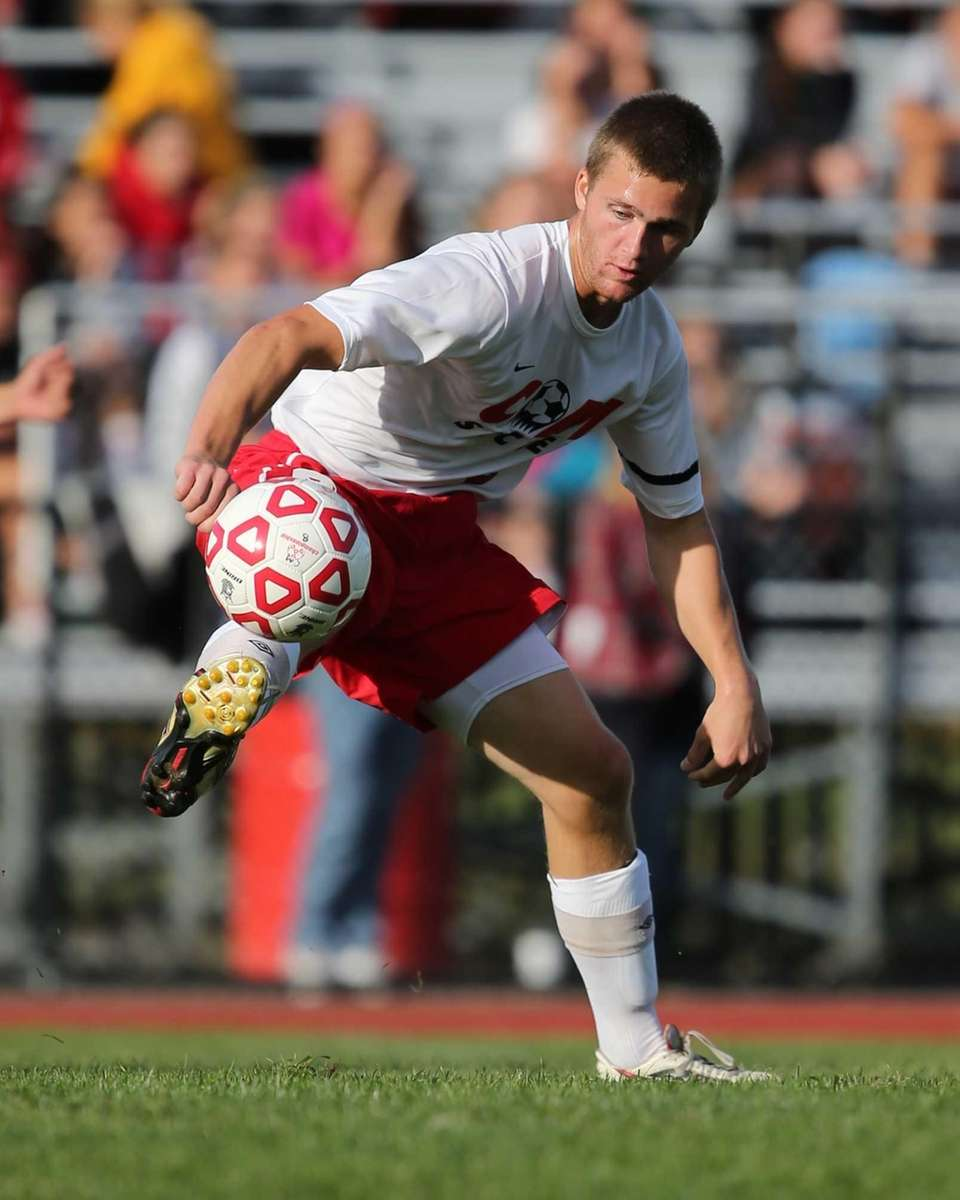 Cameron Stankelis of Center Moriches comes down with