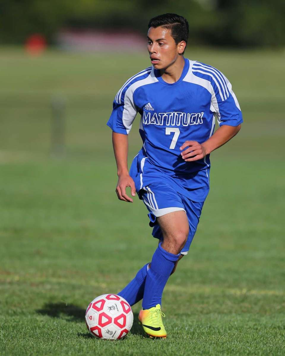 Mattituck's Mario Arreola moves the ball down field