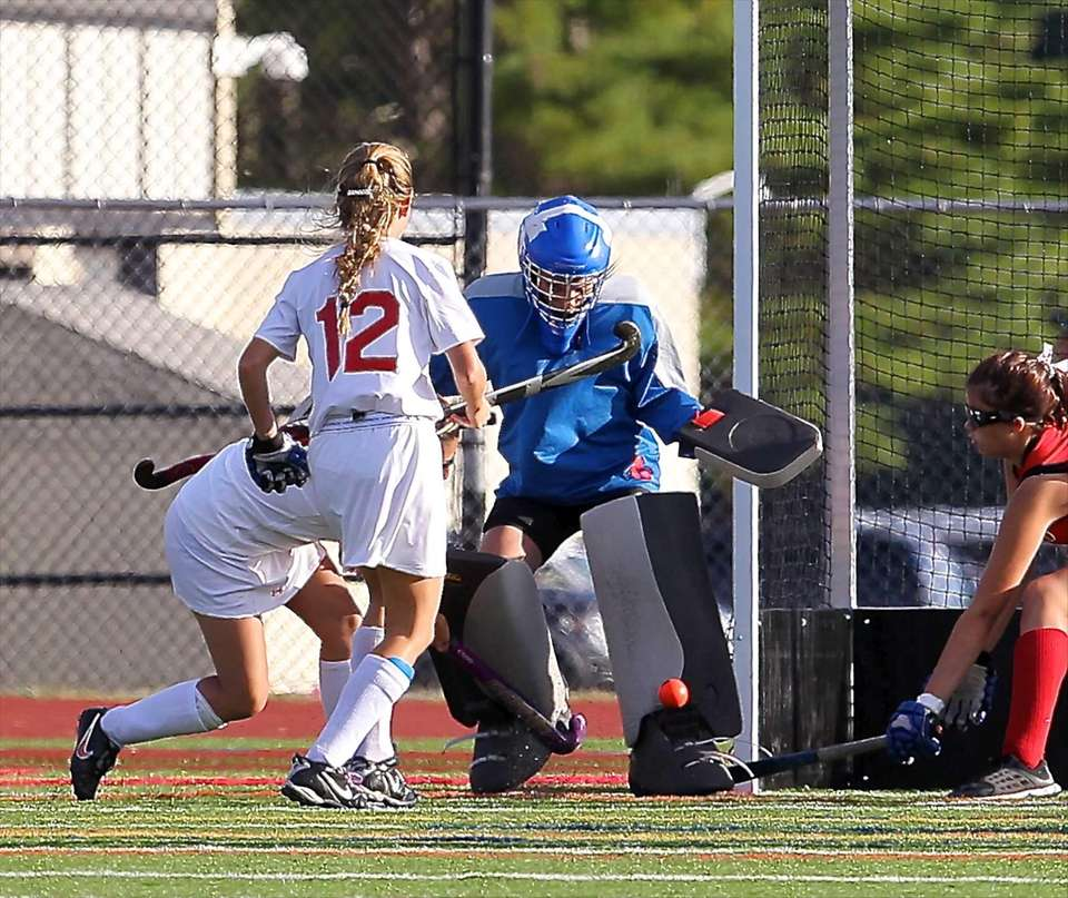 Newfield goalie Madison Skelton makes the point blank