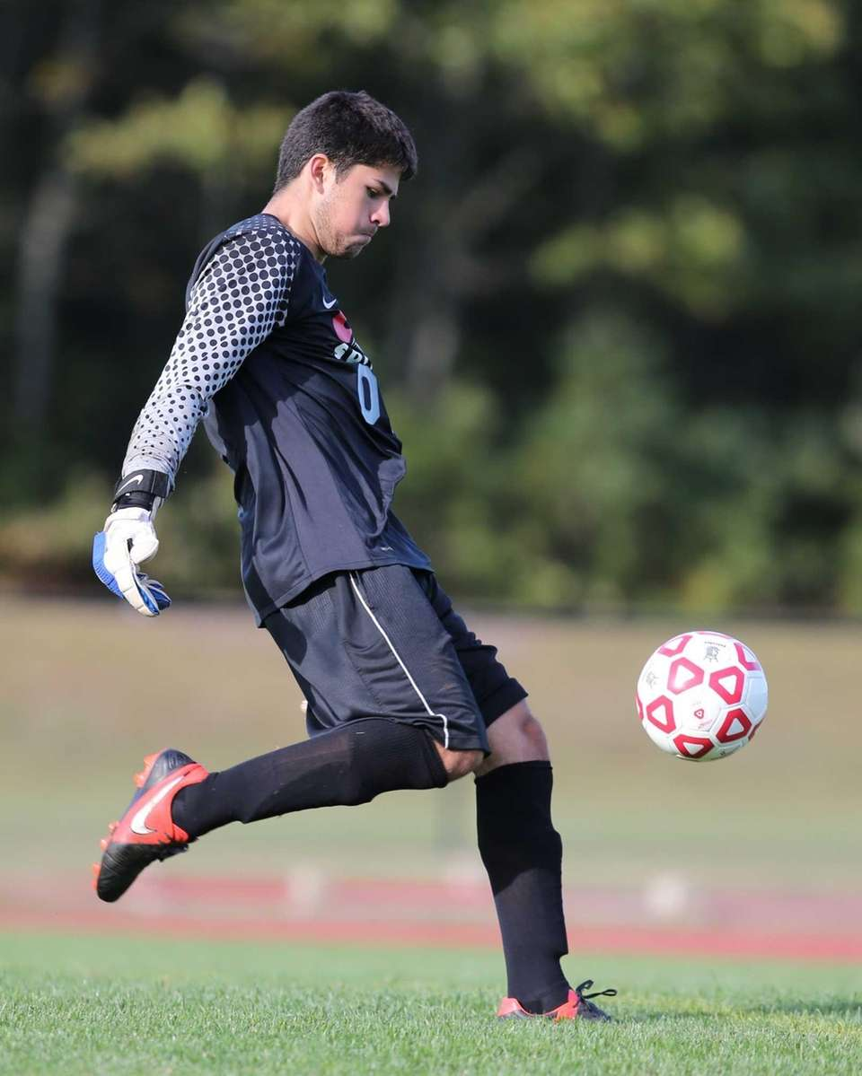 Center Moriches goalie Peter Connolly clears the ball