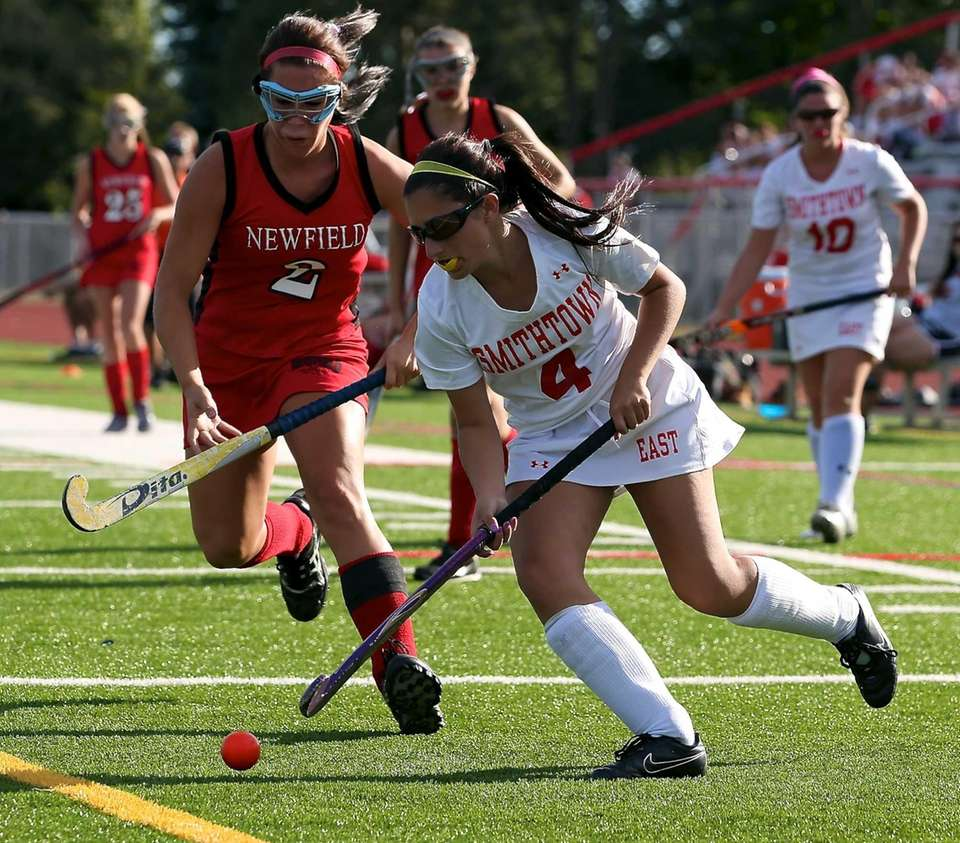 Smithtown East forward Jenna Marx moves past Newfield's