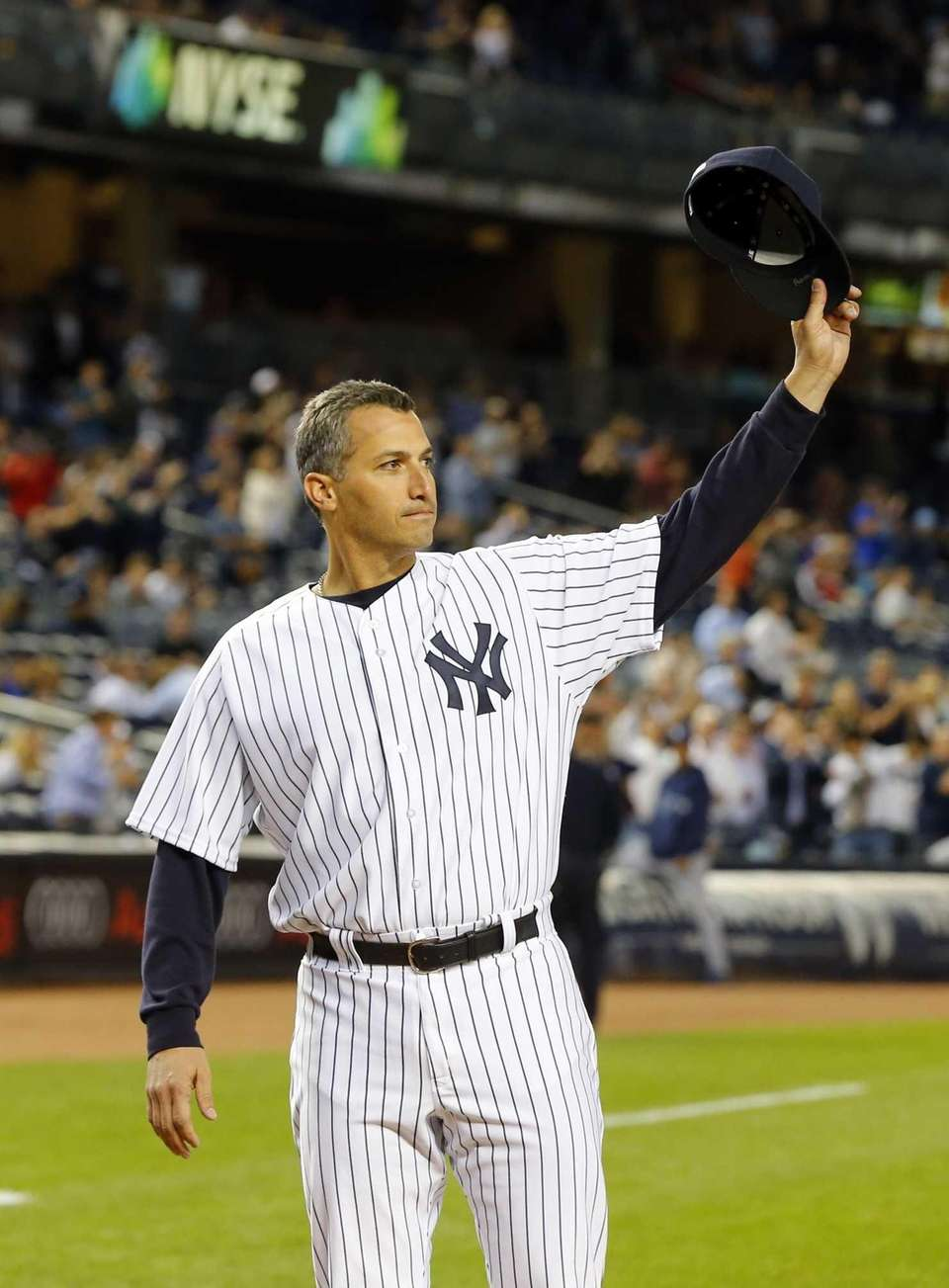 Andy Pettitte of the Yankees salutes the crowd