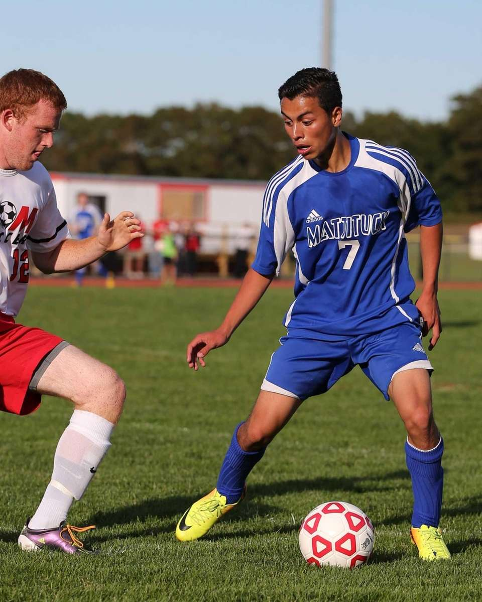 Mattituck's Mario Arreola moves the ball upfield against