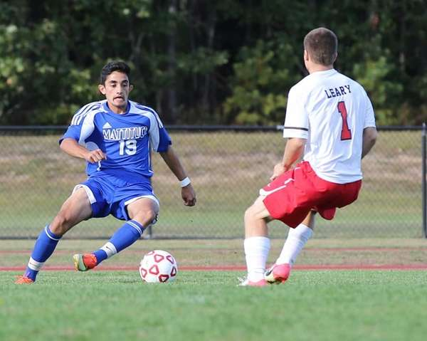 Mattituck's Kaan Ilgin moves the ball down field