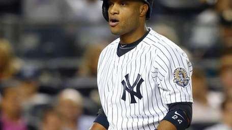 Robinson Cano of the Yankees reacts to a
